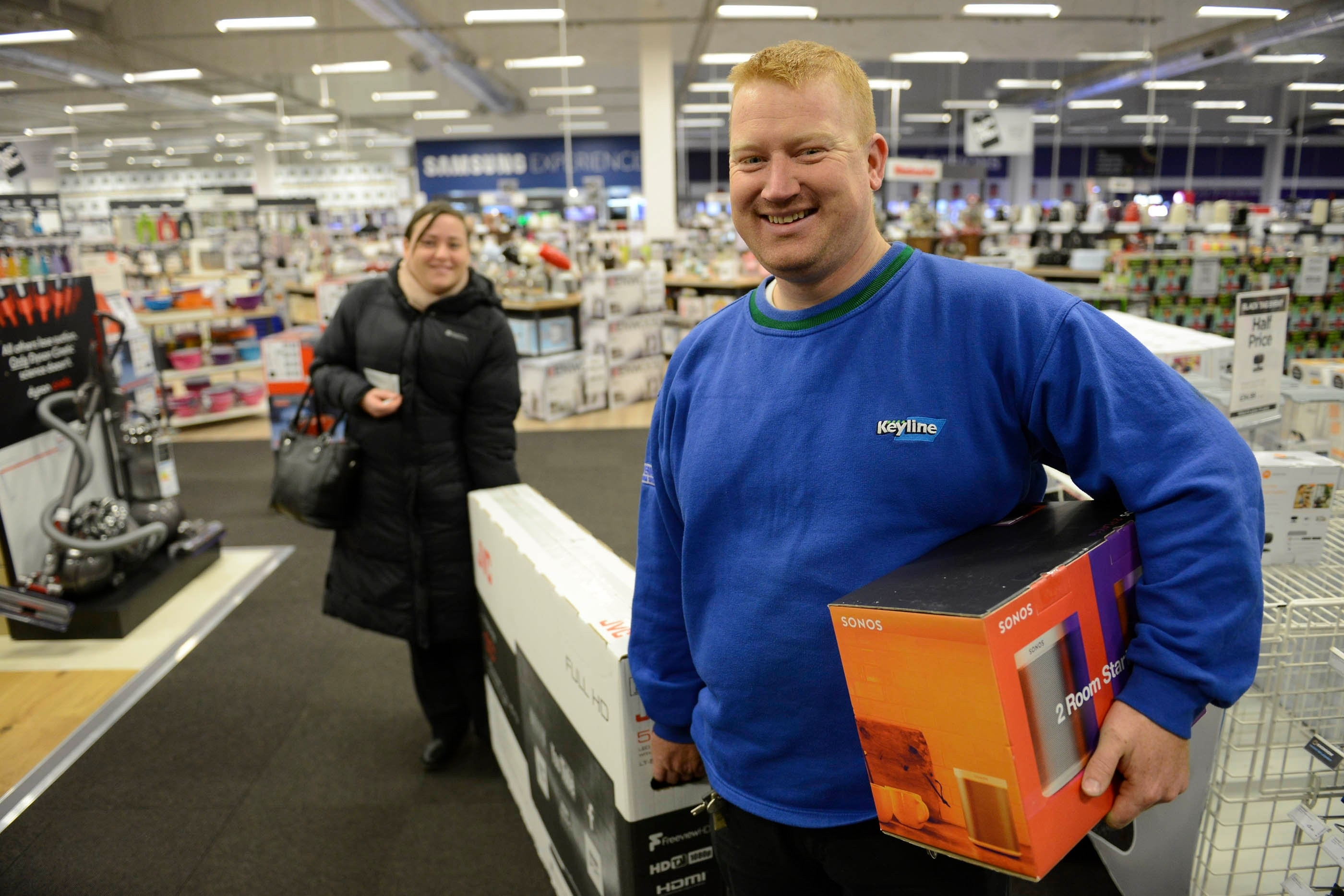 Lesley Ann O'Donnel and husband David O'Donnel, from Glasgow, one of the first customers in the shop, bags a bargain at Currys PC World, intu Braehead, Glasgow, for Black Friday sales, November 27, 2015. Large crowds did not materialise despite the bargains on offer with very few shoppers being in the store shortly after opening at 6am.