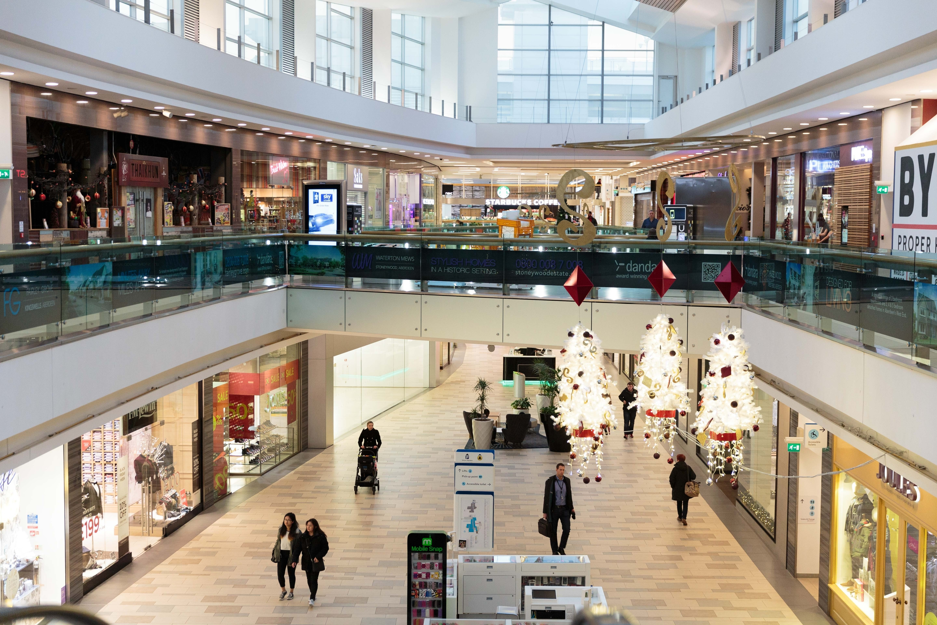 Aberdeen Scotland, Friday 27th November, 2015. - The Black Friday sales have begun, but early signs are that UK stores have seen smaller crowds than last year as sales switch online. Pictured: Union Square in Aberdeen looking empty.