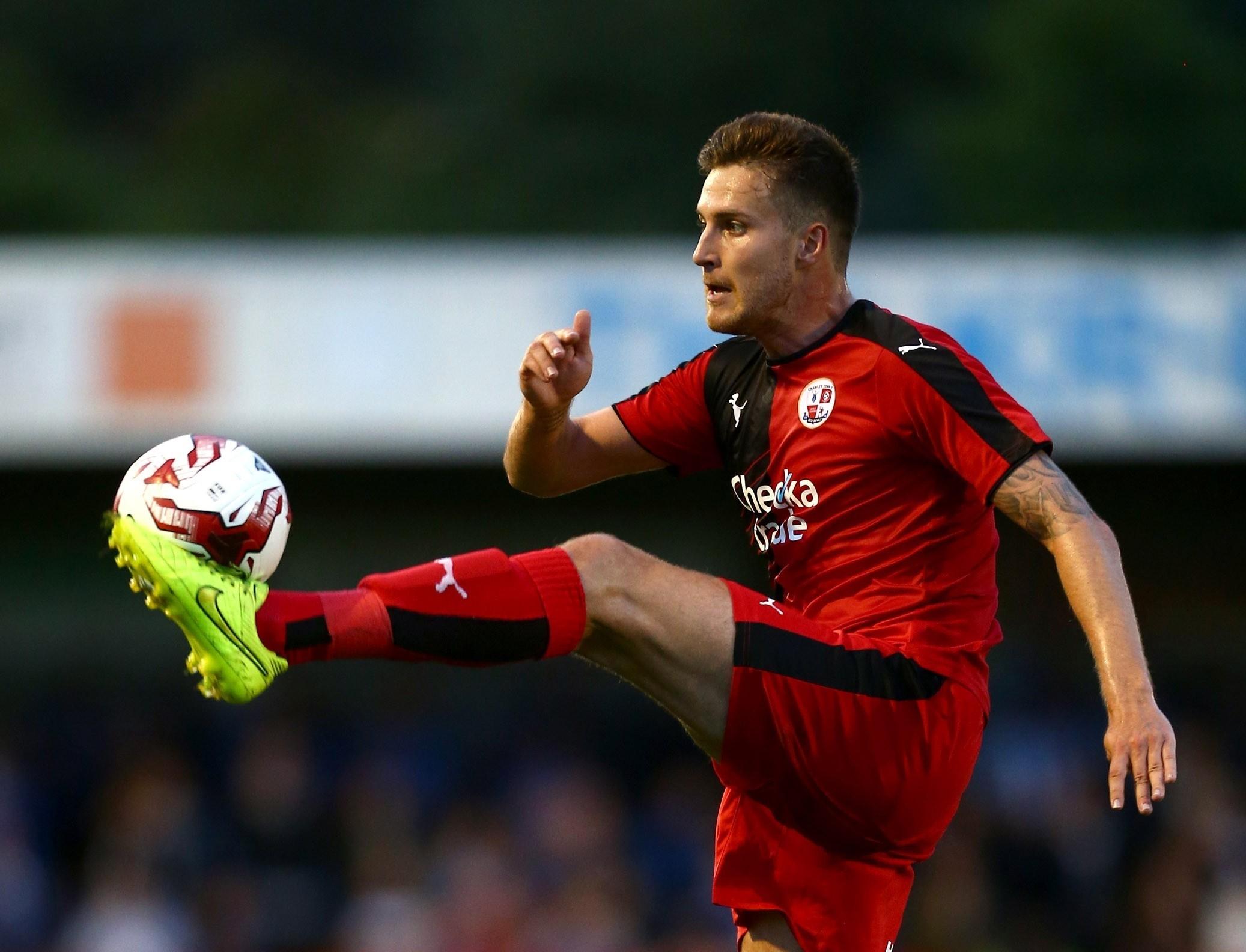 Conor Henderson in action for Crawley