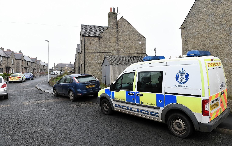 Police start a raid on a home in Fraserburgh