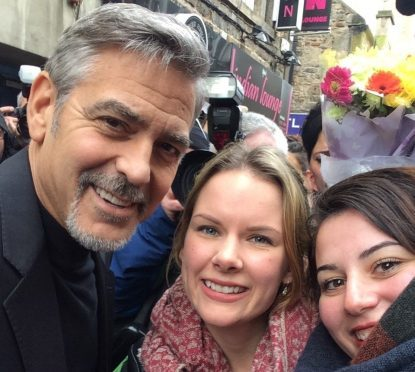 George Clooney takes a selfie with fans Malin Wilje and Merita Selmani as he arrived at Social Bite in Edinburgh.