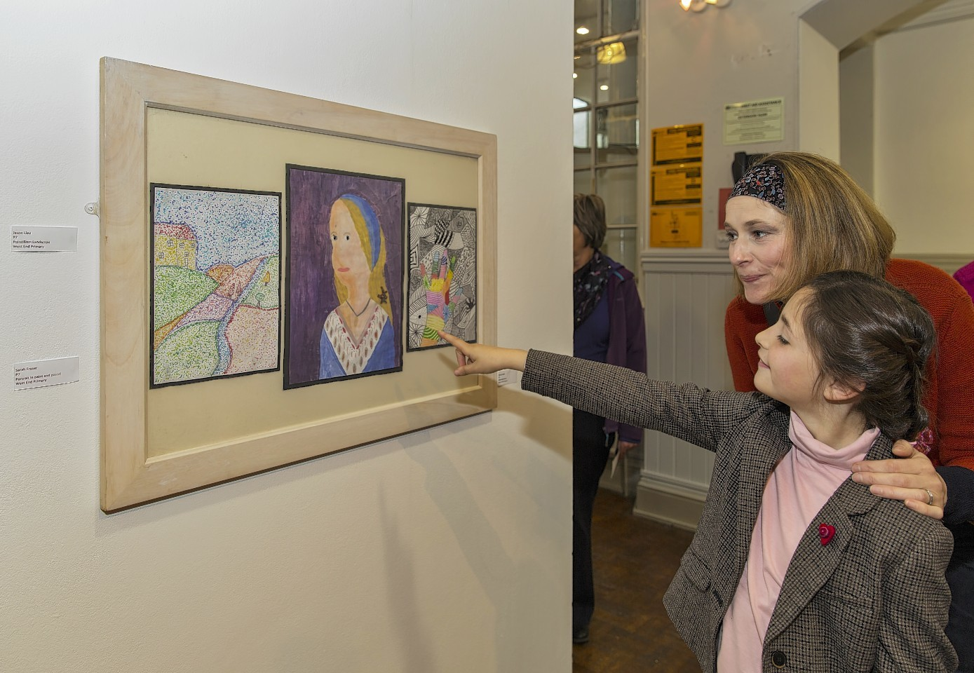 Forres Academy art and design teacher Helen Cole with her daughter Erin admiring the artwork.