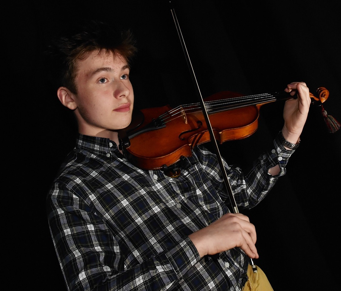 Young violin player Finlay Morse, 13, from Dyce. Picture by Colin Rennie