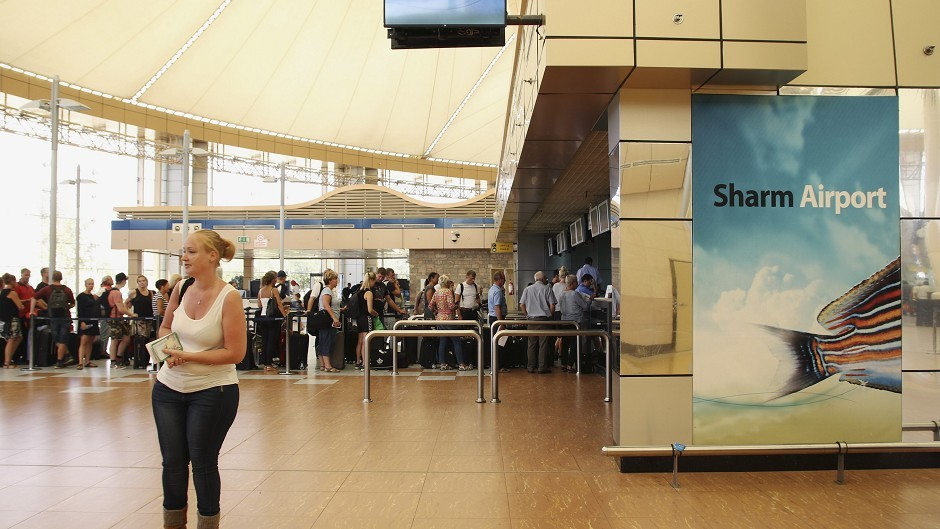 Tourists wait in the departure hall to be evacuated from Sharm el-Sheikh airport, south Sinai, Egypt (AP)