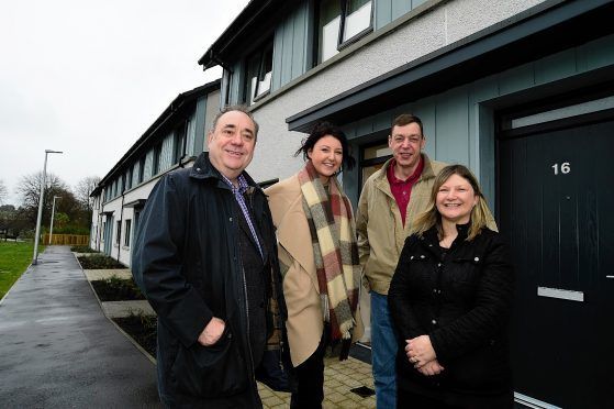 Alex Salmond meets tenants Graham and Summers and daughter Lucy at the new housing project in Strichen