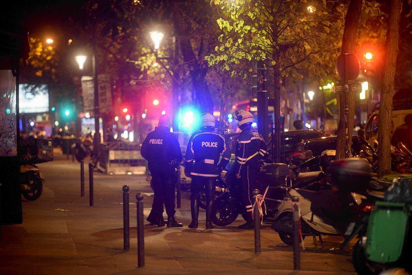 Gunfire and explosions in multiple locations erupted in the French capital