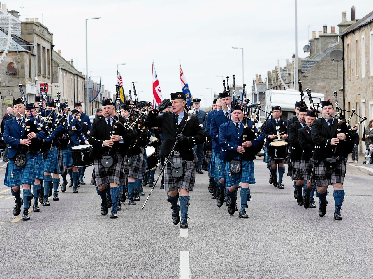 RAF Lossiemouth take the salute before the laying of wreaths at the war memorial Esplanade at Lossiemouth