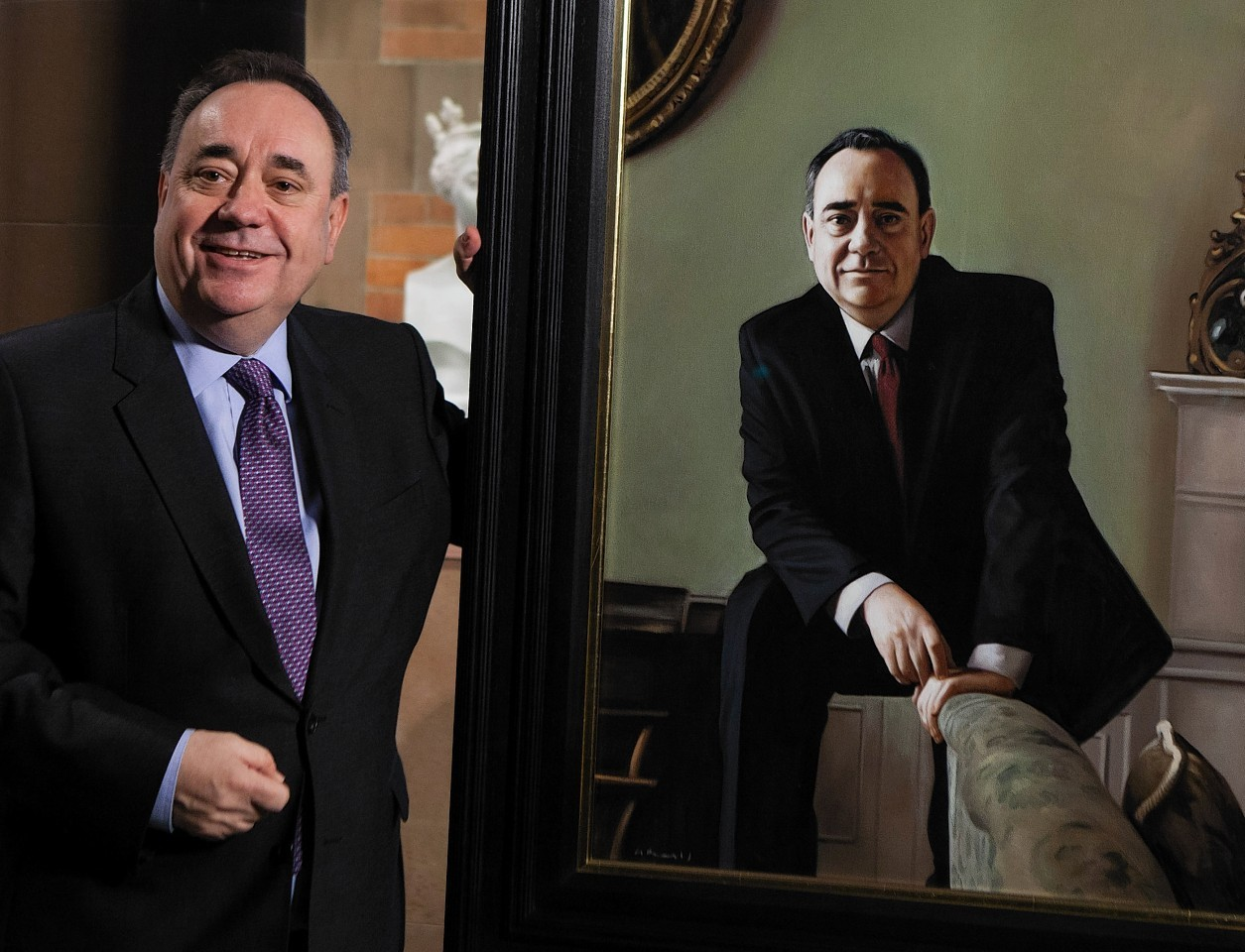 Former First Minister Alex Salmond MP unveils a portrait of himself by Gerard Burns, at the National Galleries of Scotland