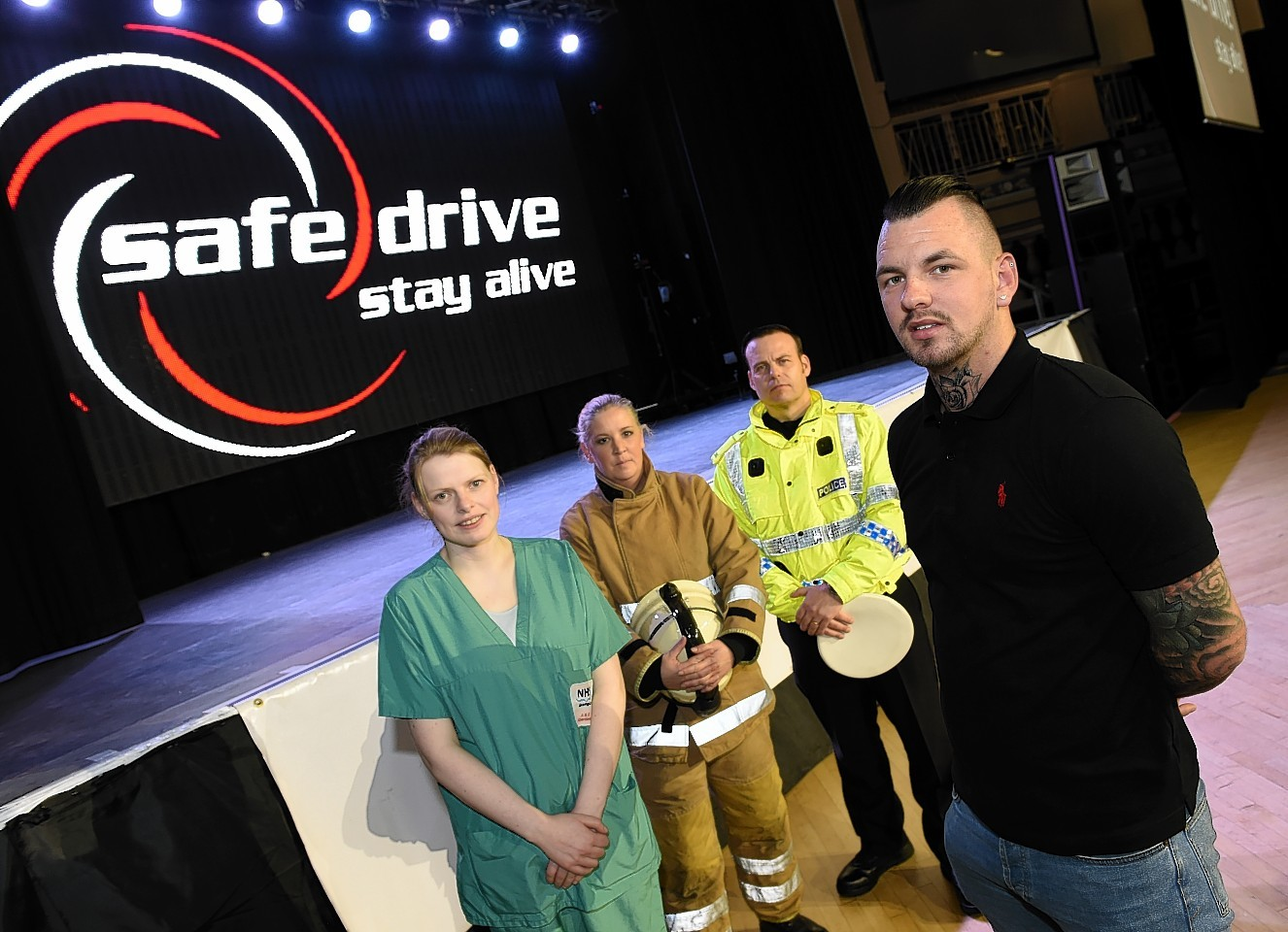 Dr June Whiteford, NHS Grampian, Lillian Shanks, Scottish Fire and Rescue Service, PC William Wallace, Scottish Police Force and ex Elgin City footballer Chris Tucker taking part in Safe Drive Stay Alive road safety show at the Beach Ballroom