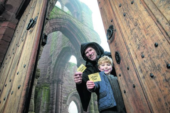 Bruce Fraser, 5, from Dundee, is shown around Arbroath Abbey by one of the monks from its past (played by Marcus McLeod) to help launch this year's Ticket Giveaway weekend, which takes place this Saturday and Sunday, November 28 and 29. Photo: Historic Scotland