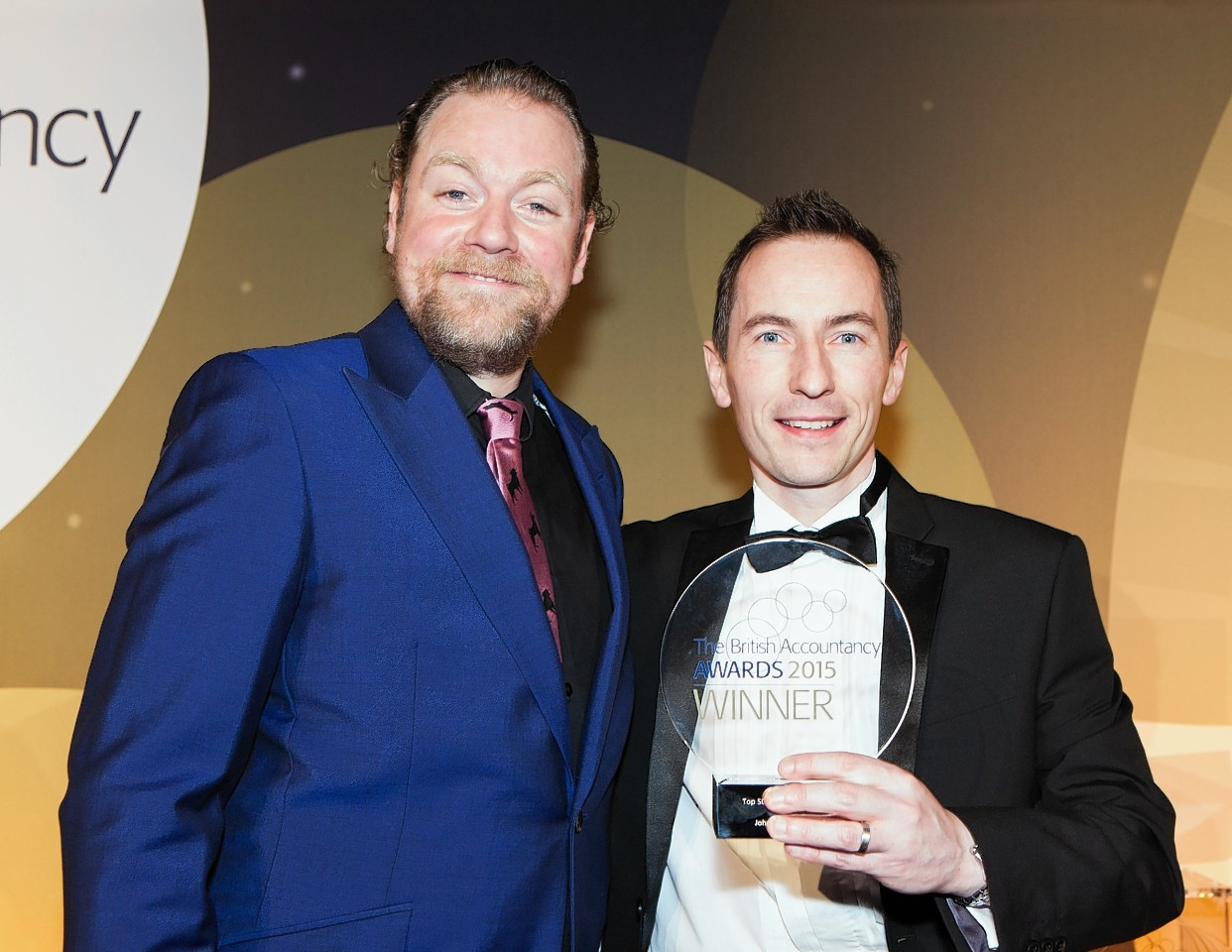 Johnston Carmichael's Donald McNaught, right, picks up the award for restructuring project of the year, with Rufus Hound, at the British Accountancy Awards