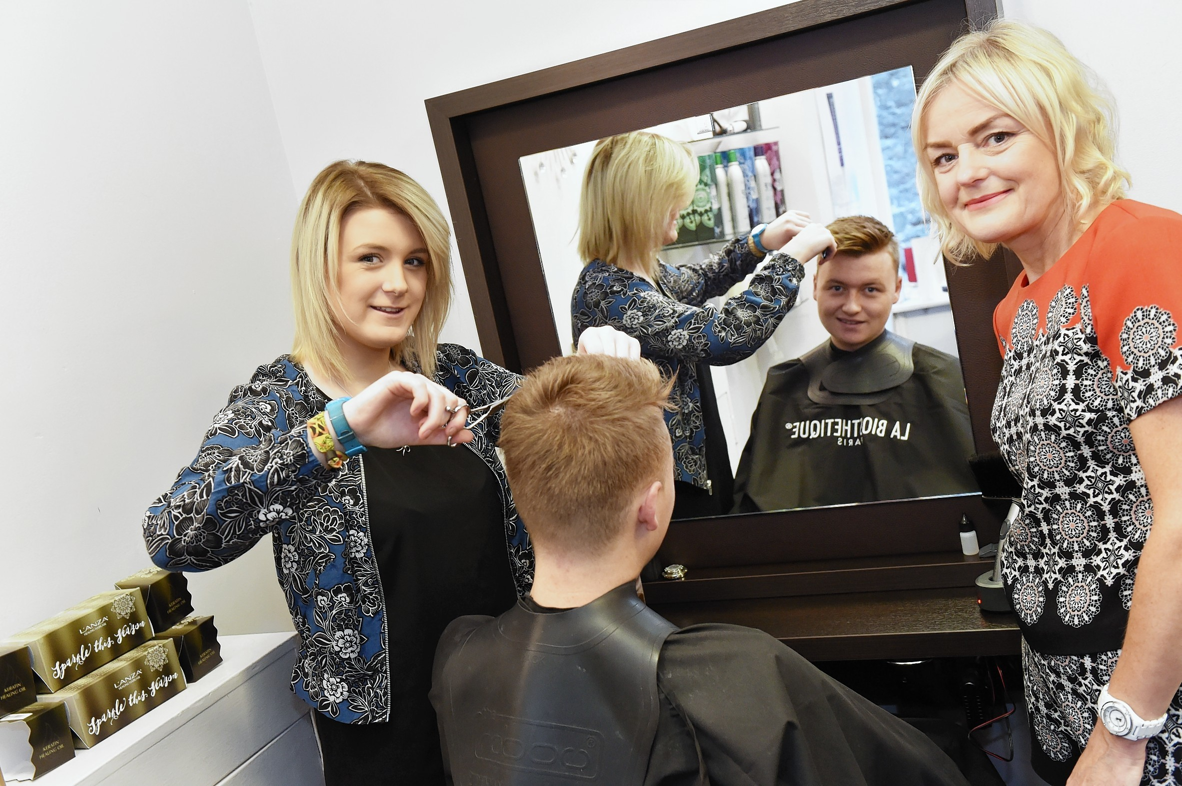 Apprentice Rebecca Monk (left) with customer Irvine Barber and owner Donna Frost.