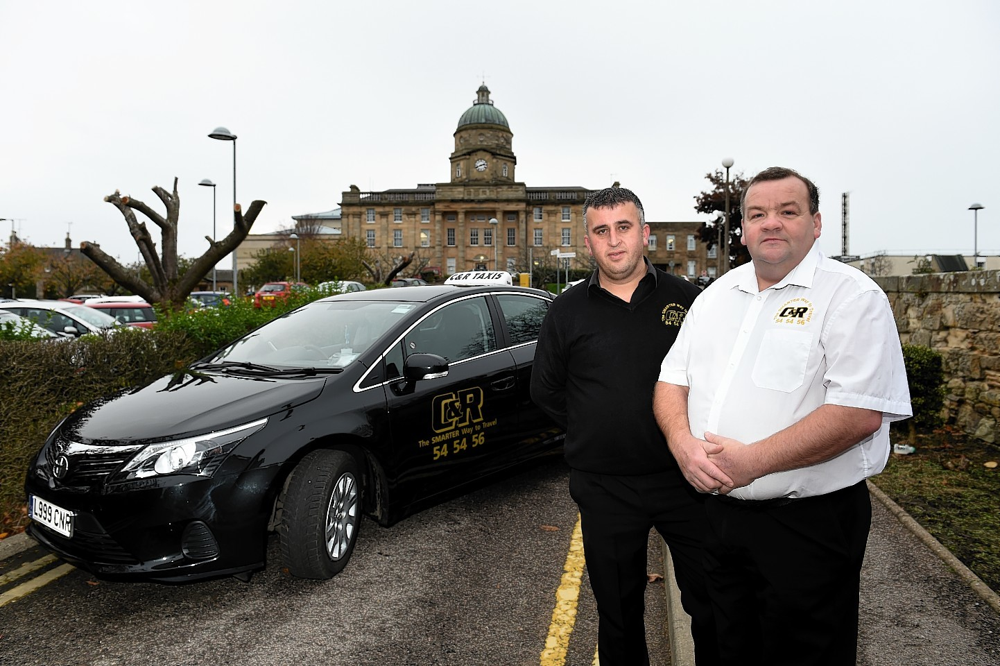 C&R Taxis boss Rod McLennan (white shirt) and driver Osman Kahraman. Picture by Kenny Elrick