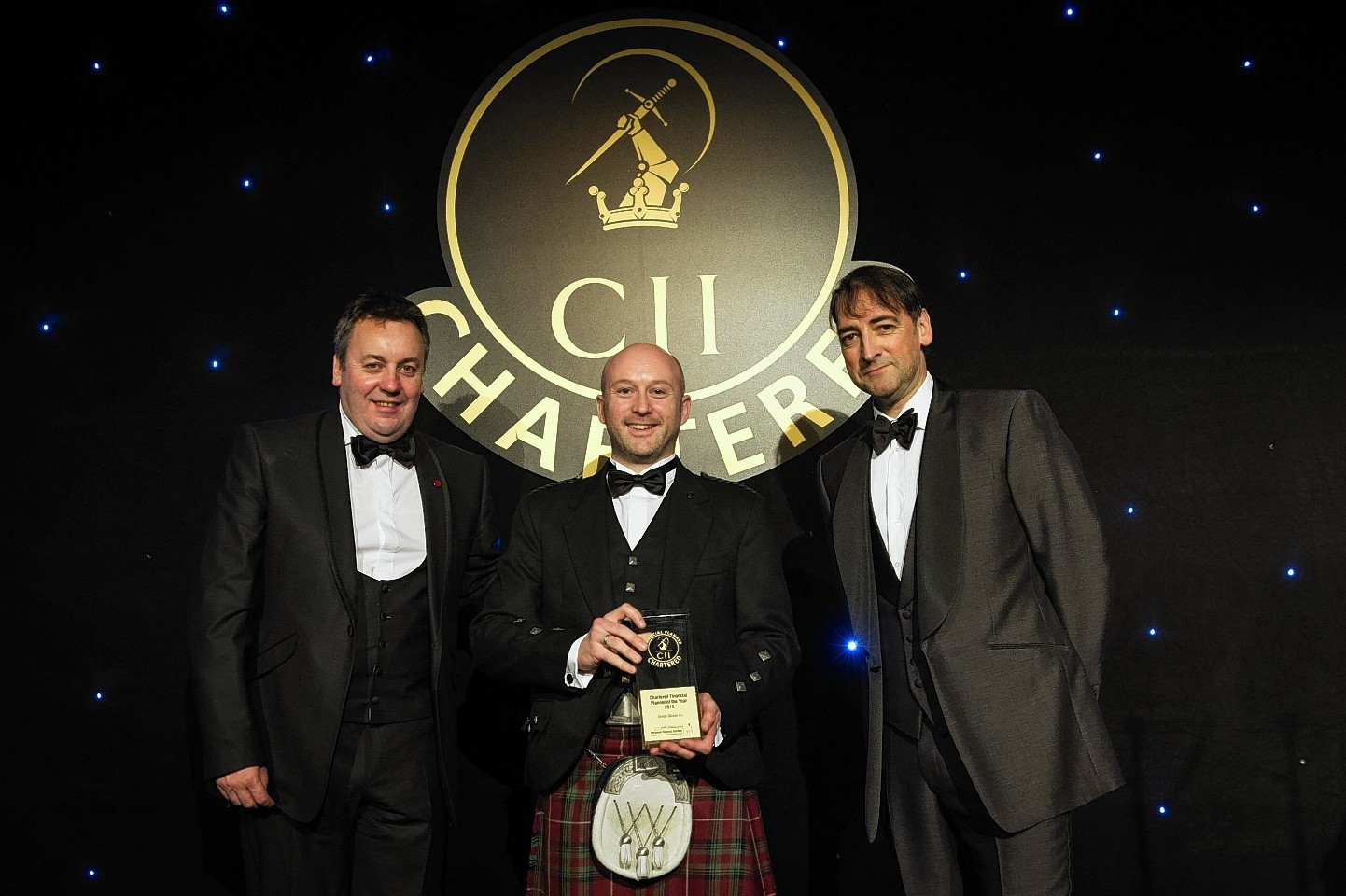 Simon Glazier, Andrew Megson, retirement managing director at financial services firm Partnership, and Alistair McCowan at the Chartered Awards