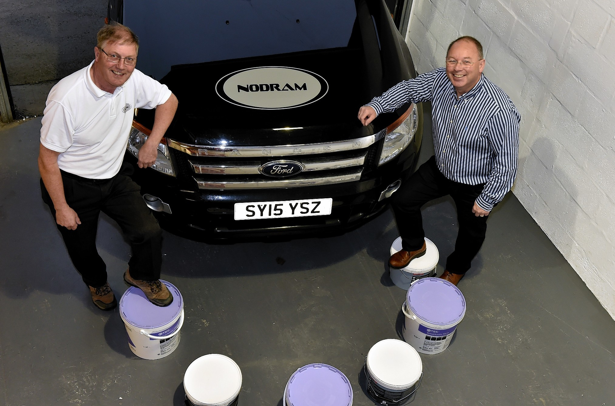 Nodram Decorators (North) Ltd at Newburgh. Area Direrctor Dave Torry (left) and Nodram Director Donald MacPhee.
