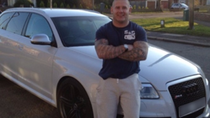 Shaun Davis with one of his cars