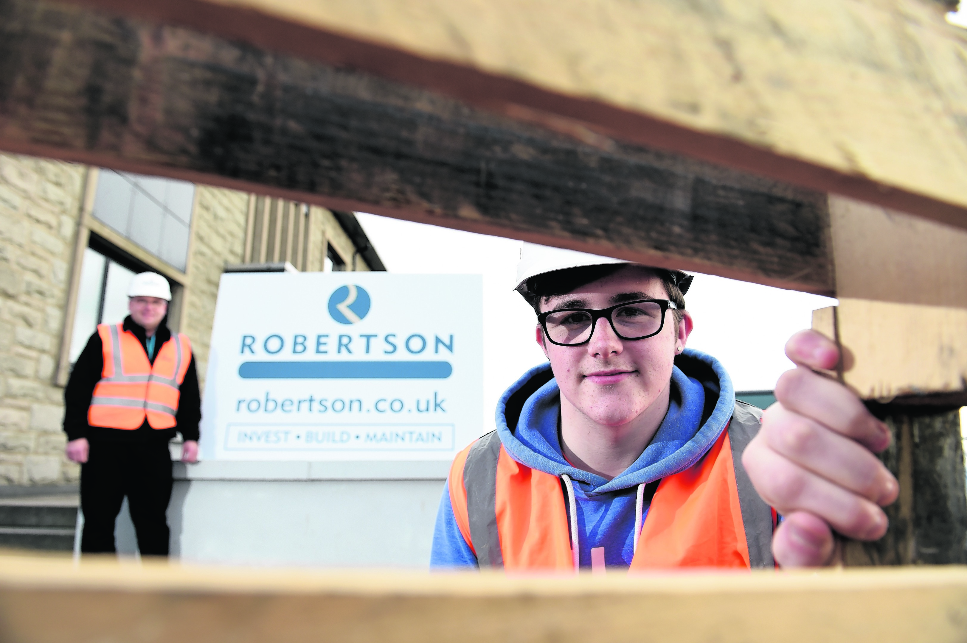 Apprentice joiner Cameron McLeod at Robertson Group, and Steve Anderson (site manager) was an apprentice 25 years ago.