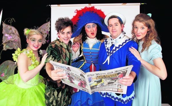 The cast catching up with the news in their P&J