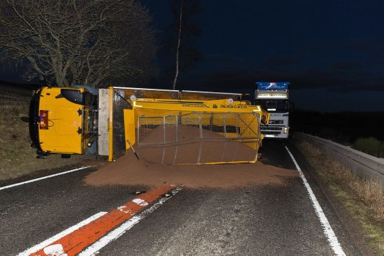 An overturned gritter on the A95