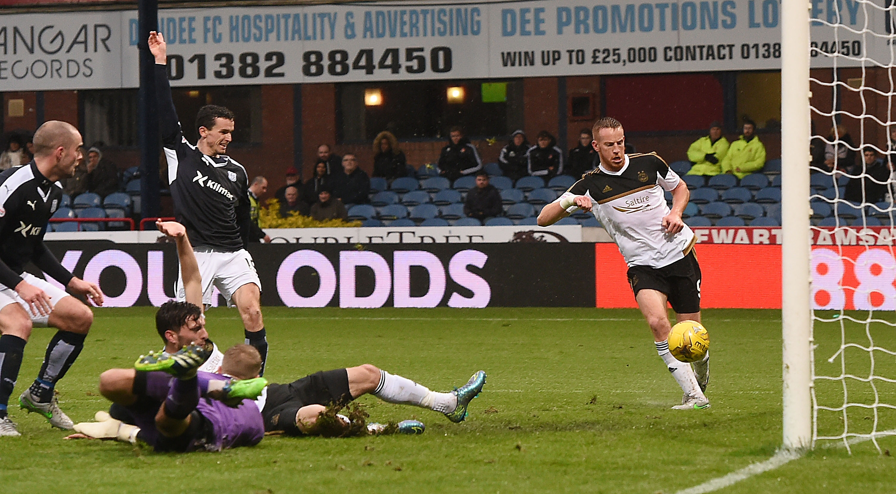 Adam Rooney prods the ball into the empty net to double his side's lead