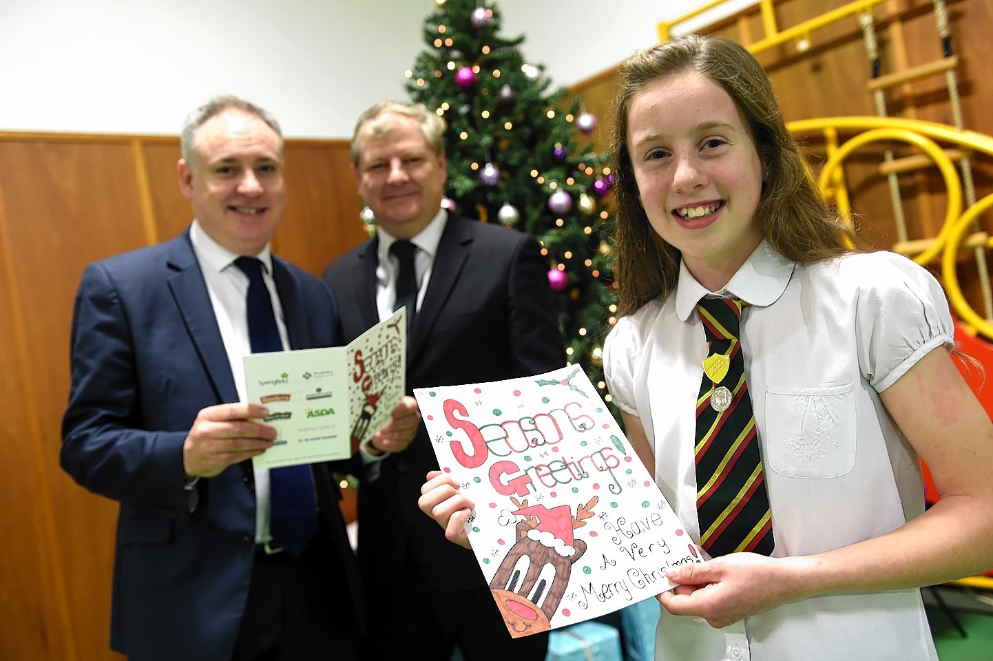 Alanna Pick, with her Christmas Card design, Richard Lochhead, MSP, left, and Angus Robertson, MP, centre. Picture by Gordon Lennox