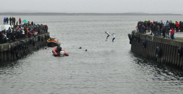 Burghead swimmers jump into the harbour