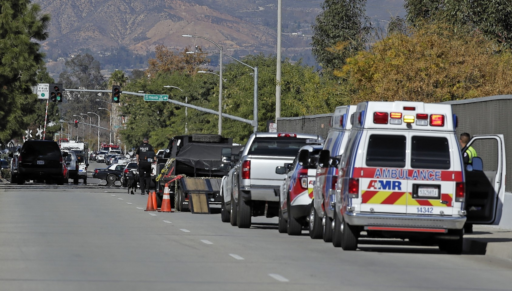 Law enforcement members line up near the the site of the mass shooting