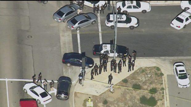 First responders gather outside a Southern California social services center in San Bernardino