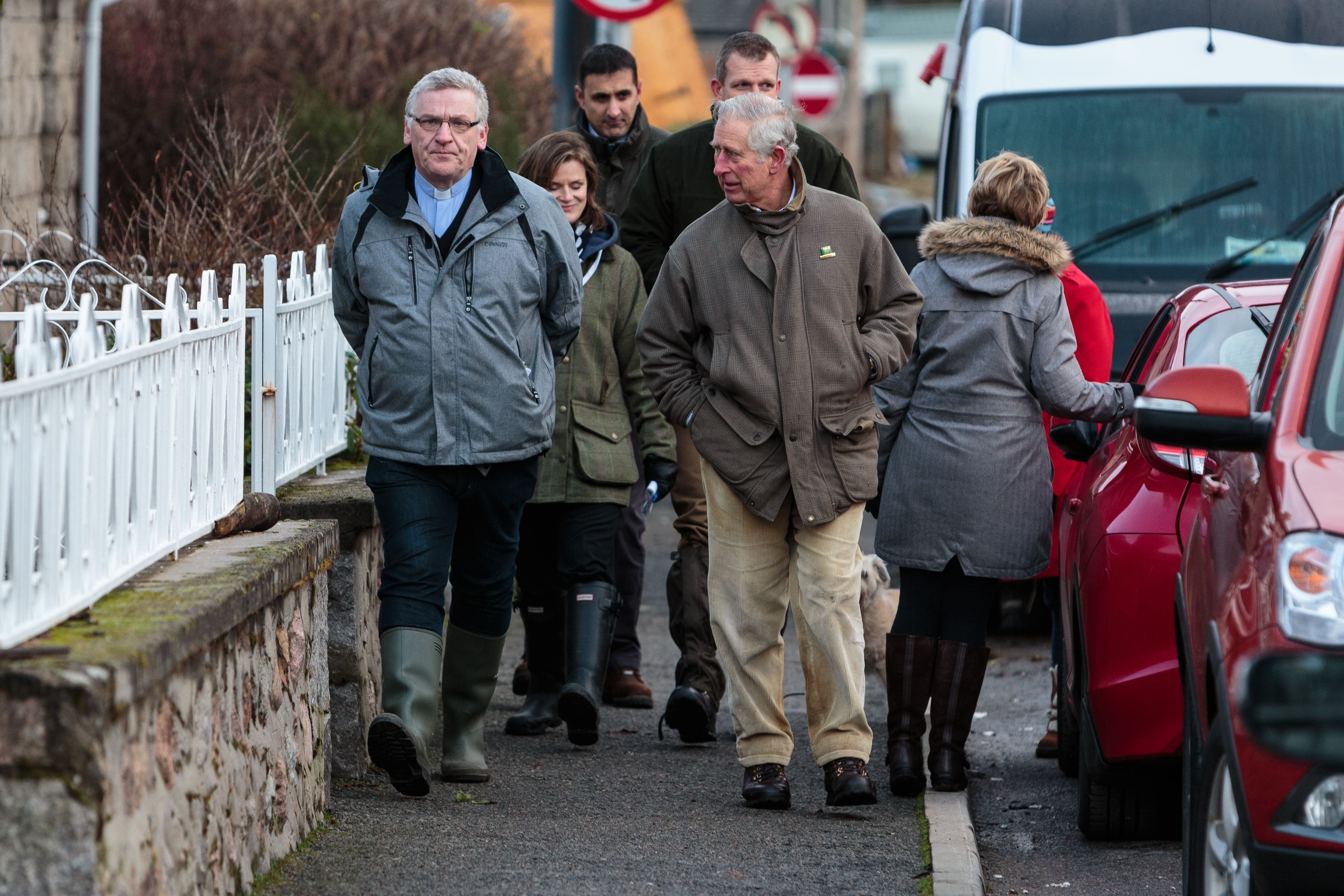 Prince Charles speaks to residents in Ballater amongst the devastation in the wake of Storm Frank