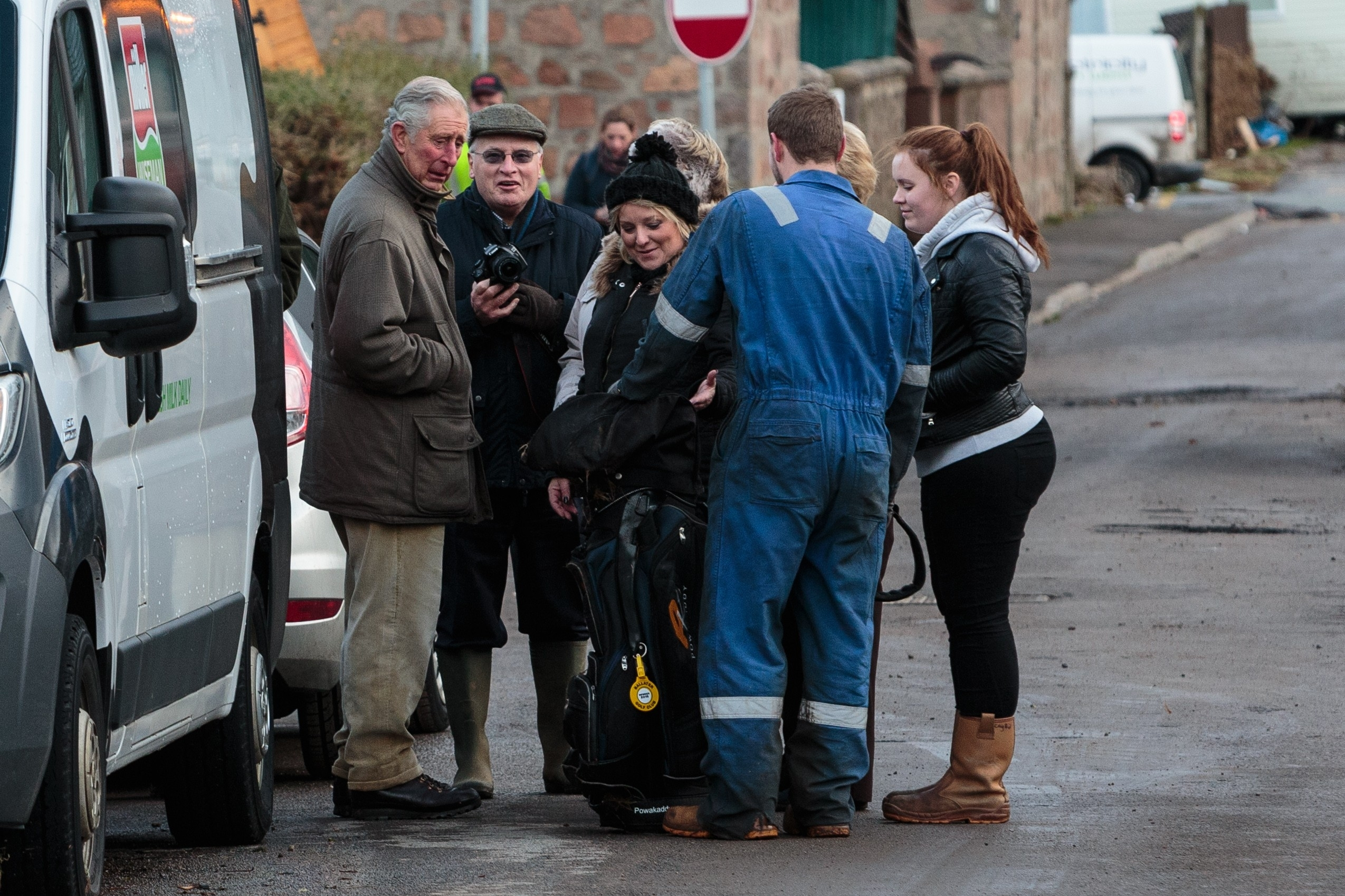 Thursday 31st December 2015, Aberdeen, Scotland. The aftermath of Storm Frank is revealed as residents of Ballater begin the clear up on New Years Eve Pictured: Prince Charles speaks to residents in Ballater amongst the devistation in the wake of Storm Frank (Photo: Ross Johnston/Newsline Media)