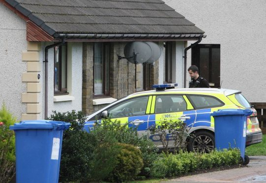 Police on the scene at Coiltie Crescent. Picture: Andrew Smith