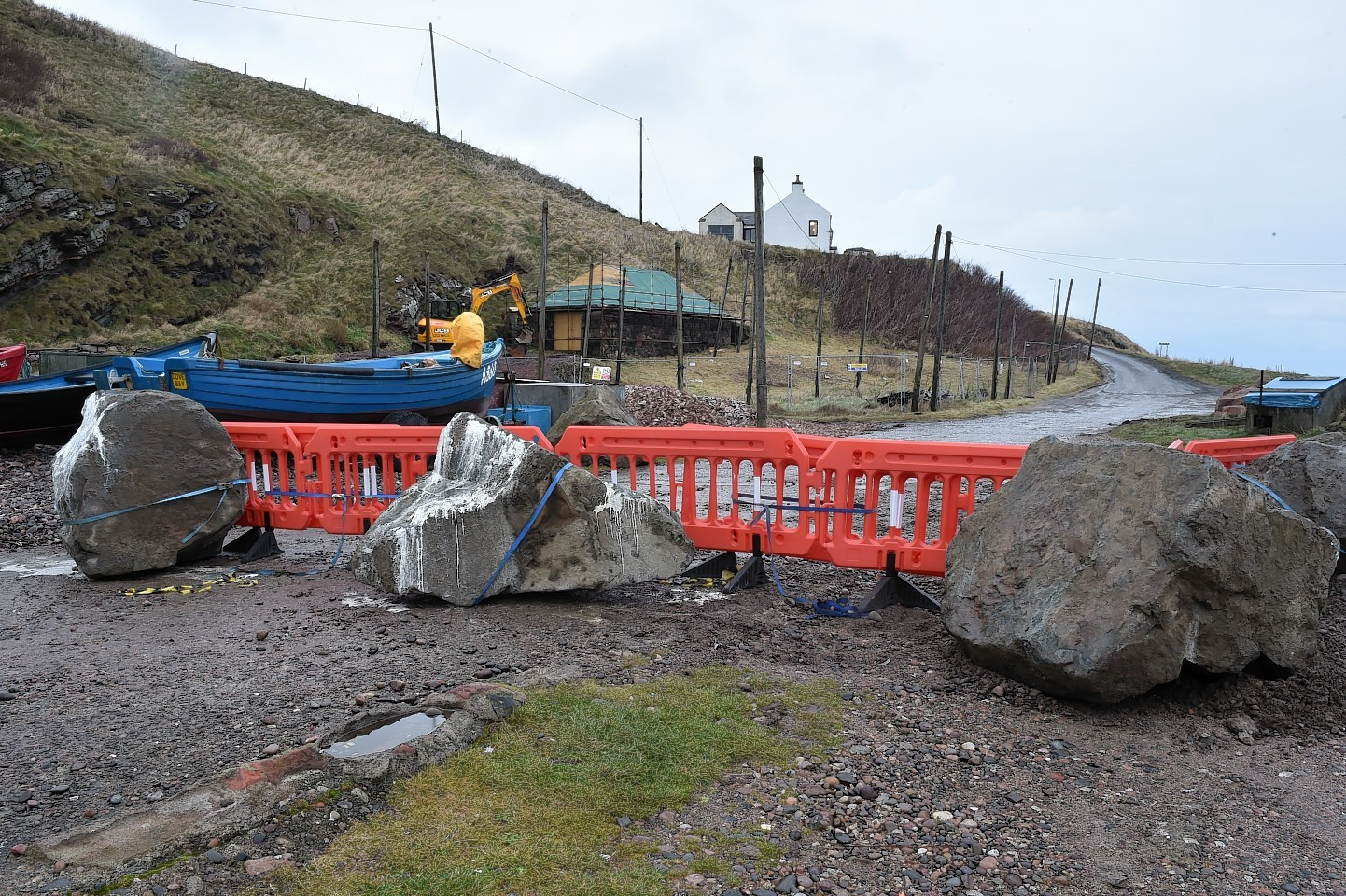 Large boulders and smaller stones at Cove Harbour to prevent access. Picture by Colin Rennie