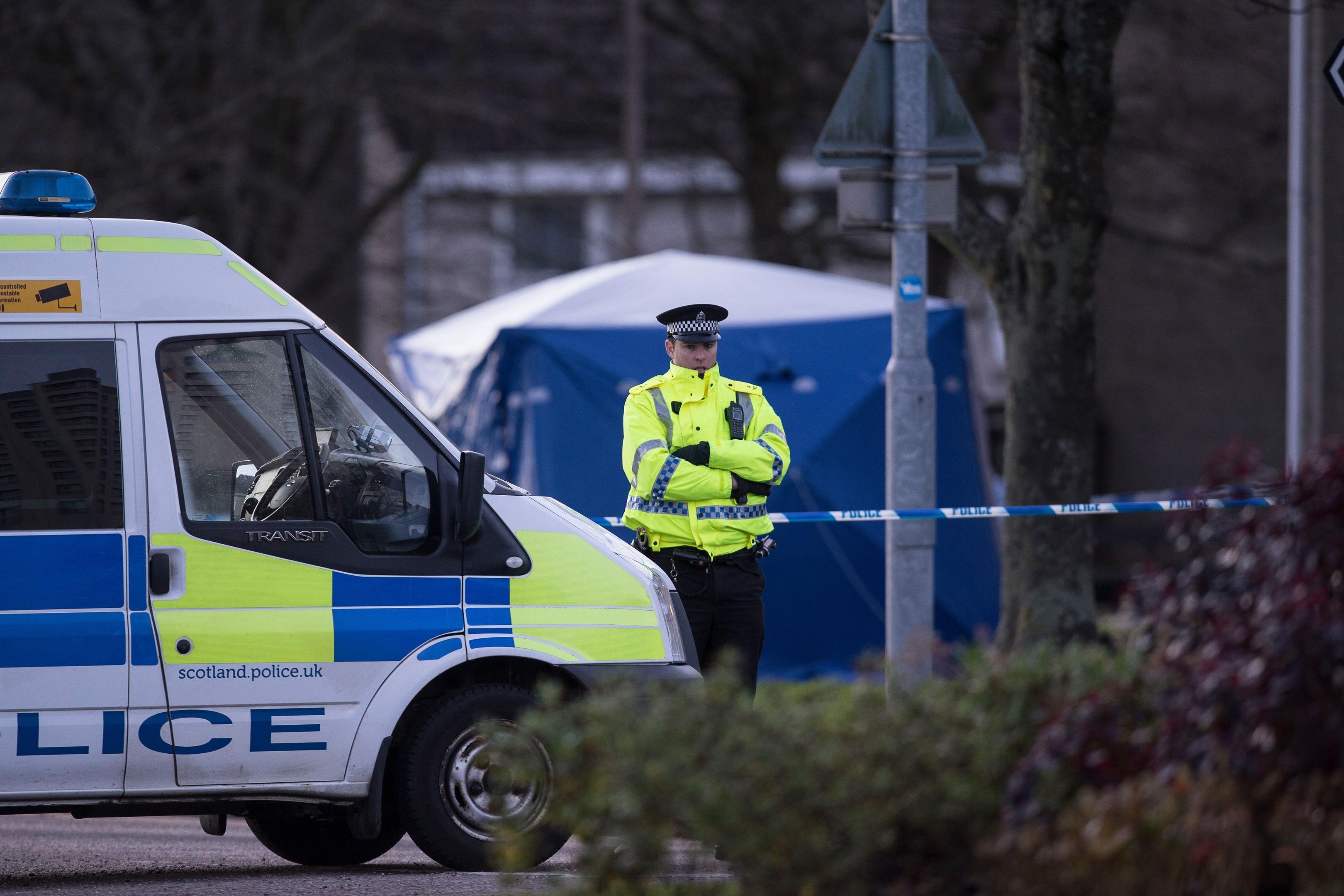 Police guard the scene on Foresterhill Road