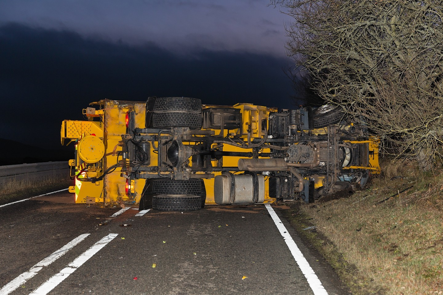 The gritter overturned on the road