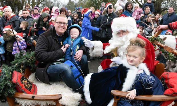 The Winter Wonderland event at Hazlehead park, Aberdeen. In the picture are santa, Kariss Bell, 5 Bruce and Jack Edmond, 8 mts. Picture by Jim Irvine  20-12-15
