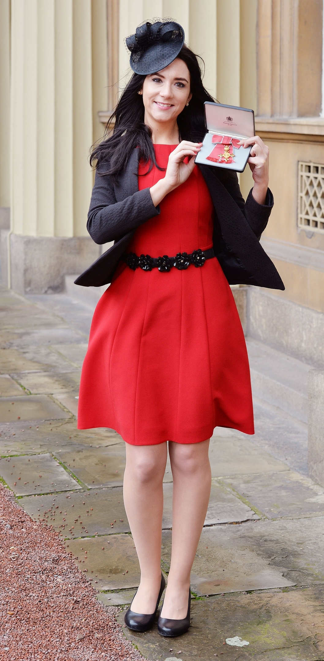 Claire Foges with her Officer of the Order of the British Empire (OBE) medal which was presented by the Prince of Wales at the Investiture ceremony in Buckingham Palace, London.