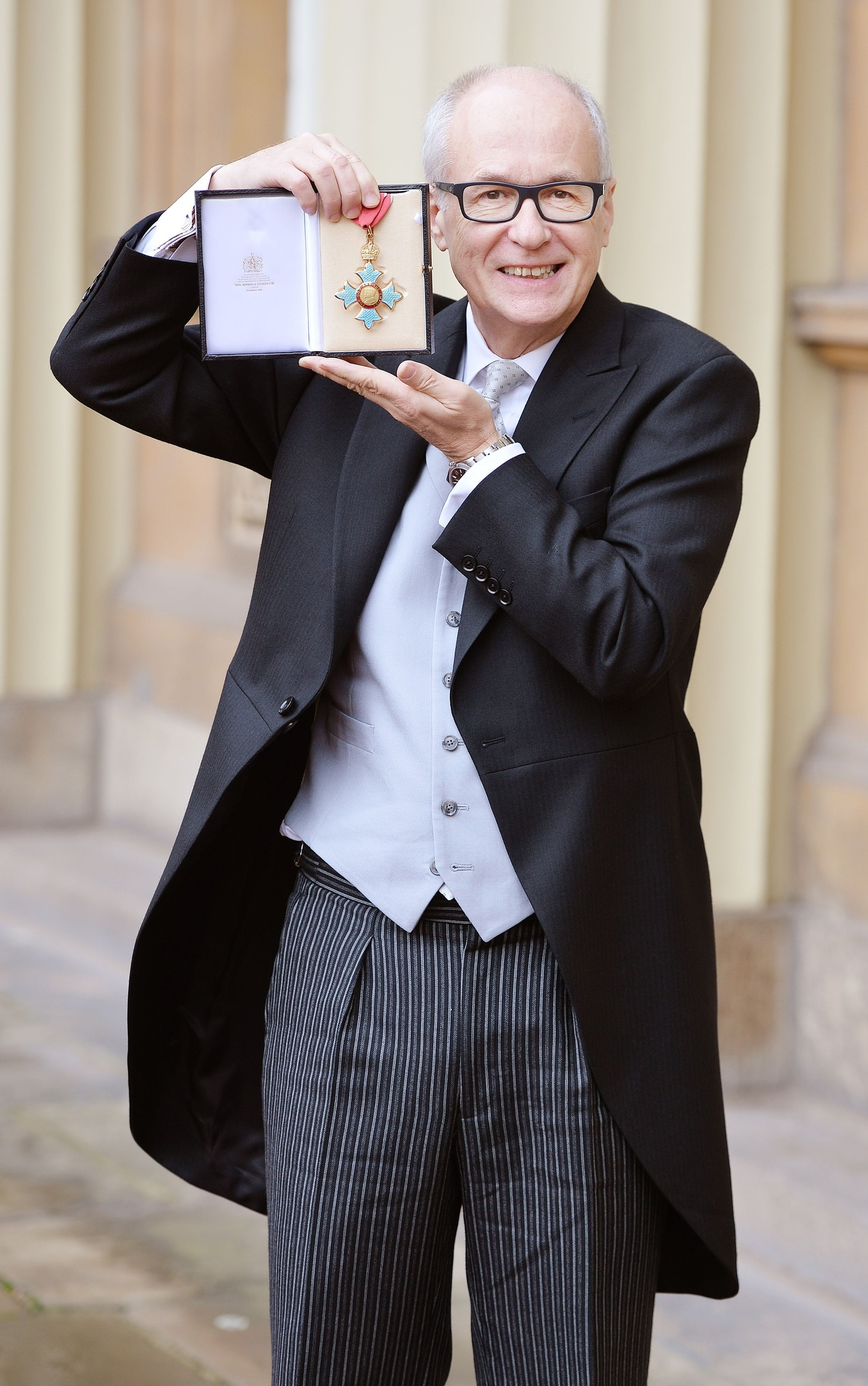 Christopher (Max) Hole with his Commander of the Order of the British Empire (CBE) medal which was presented by the Prince of Wales at the Investiture ceremony in Buckingham Palace, London.