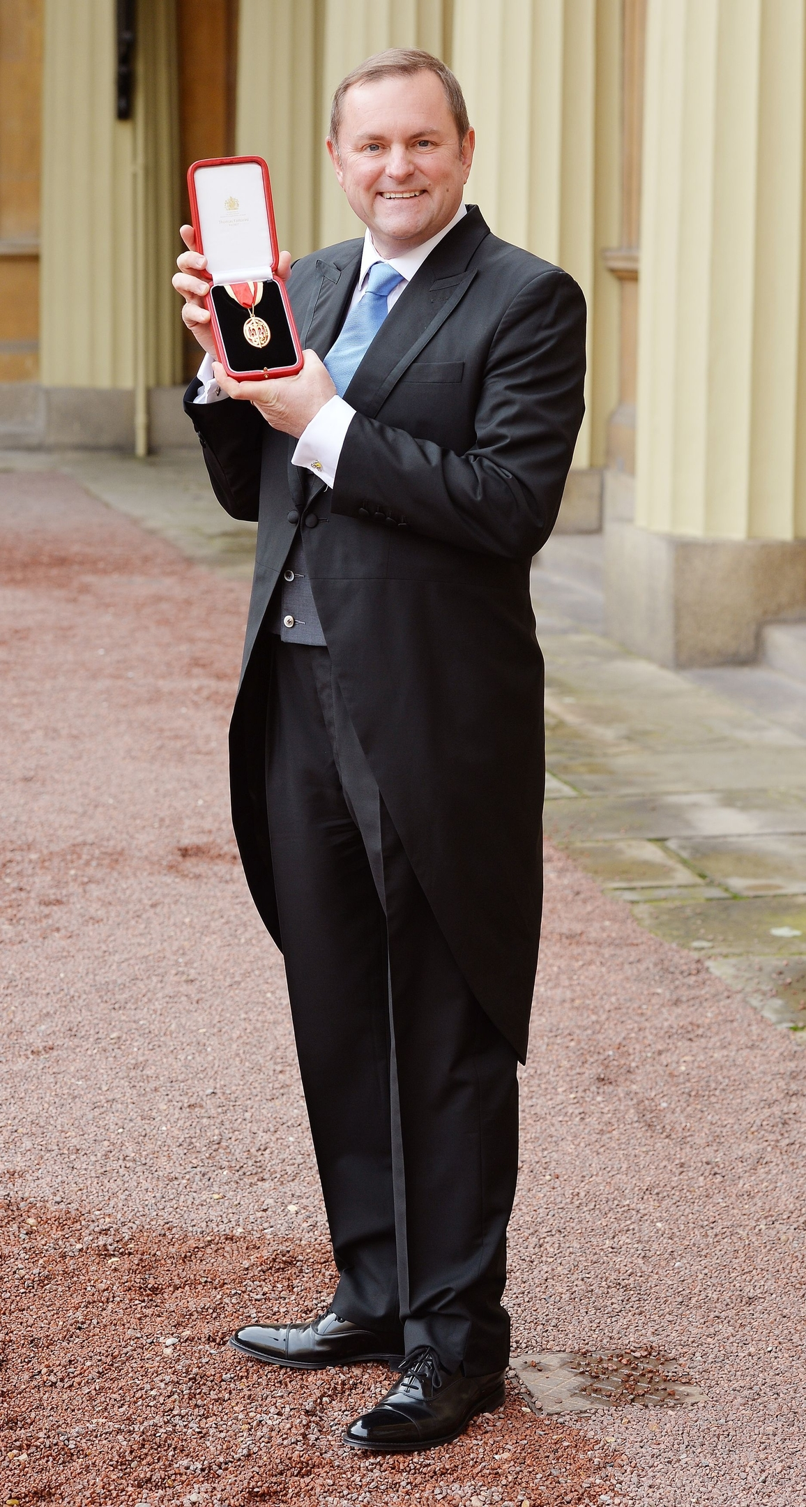 Sir Gary Verity holds his insignia of Knighthood which was presented by the Prince of Wales at the Investiture ceremony in Buckingham Palace, London.