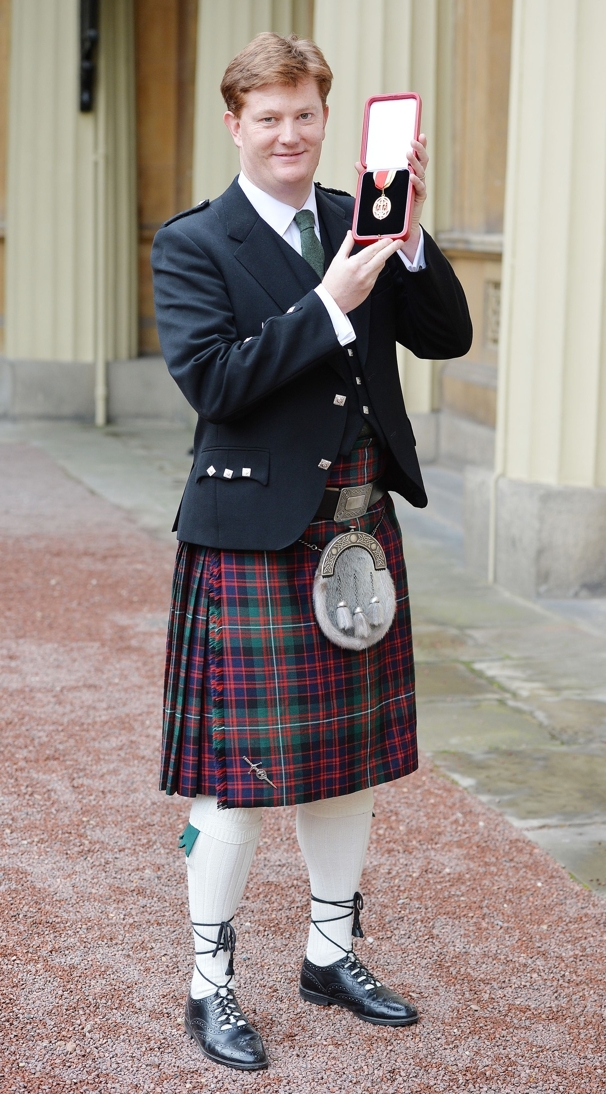 Sir Daniel Alexander holds his insignia of Knighthood which was presented by the Prince of Wales at the Investiture ceremony in Buckingham Palace, London.