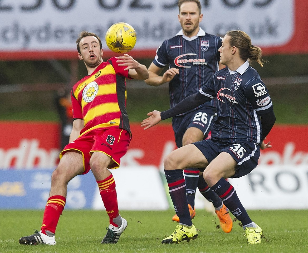 Partick Thistle's Stuart Bannigan (left) and Ross County's Jackson Irvine fight for the ball