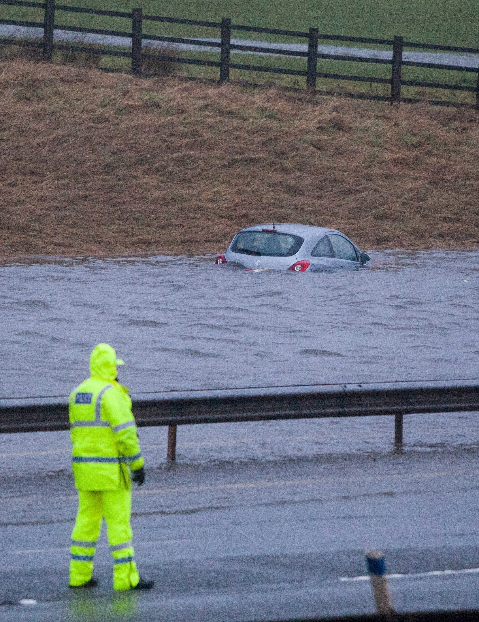 M74 northbound at J13 Abington is closed due to flooding caused by Storm Frank. Vehicles are seen floating in water and lorries pass with care. Dec 30 2015