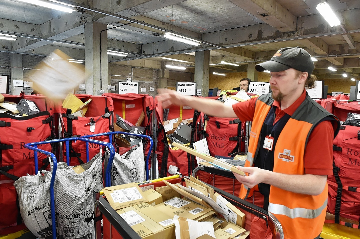 Christmas at Royal Mail in Altens, Aberdeen. Matthew Fleming sorts parcels. Picture by Colin Rennie
