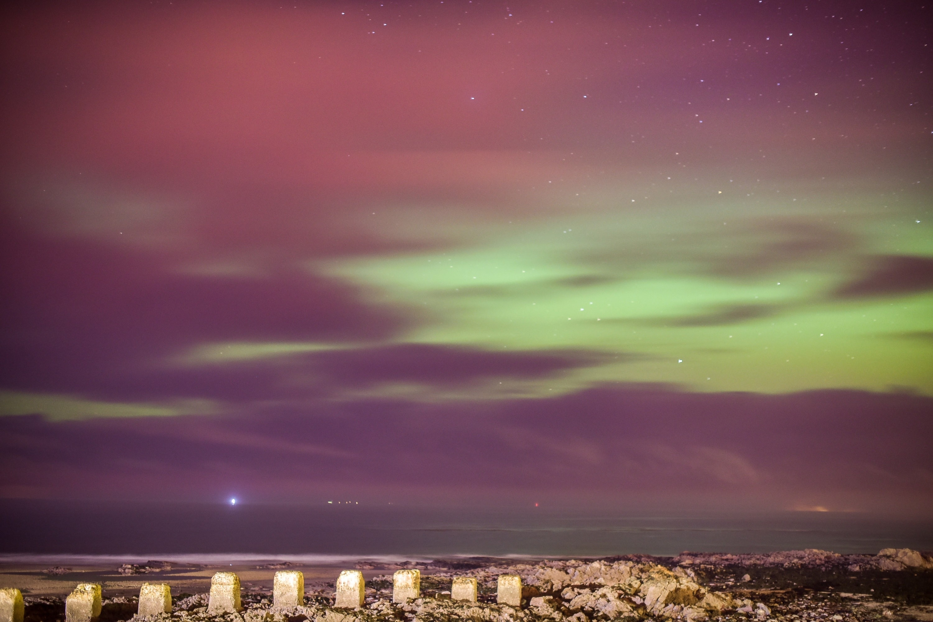 The Northern Lights, Aurora Borealis, are seen over the West Beach in Lossiemouth, Moray on December 14 2015.