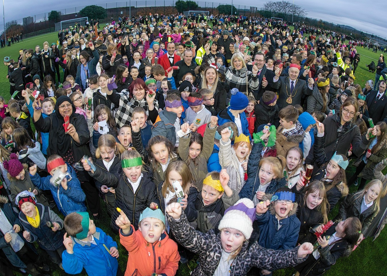 Northfield Academy pupils try to break world record for longest chain of Christmas crackers pulled at the same time