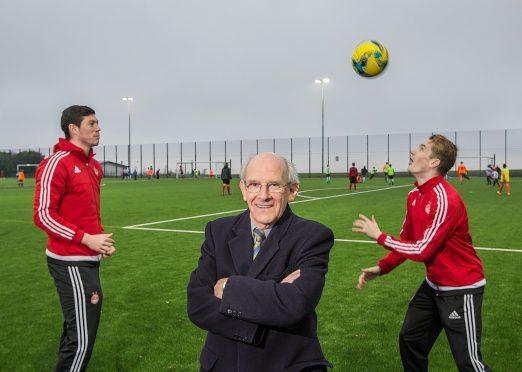 Dr George Stevenson with Aberdeen FC's Scott McKenna (left) and Scott Wright