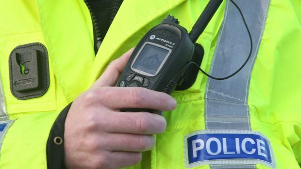 Police are in attendance at a one-vehicle crash in Oldmeldrum