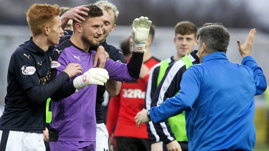 Danny Rogers, second left, celebrates with team-mates after pulling off a crucial penalty save in his side's 2-1 victory over Rangers