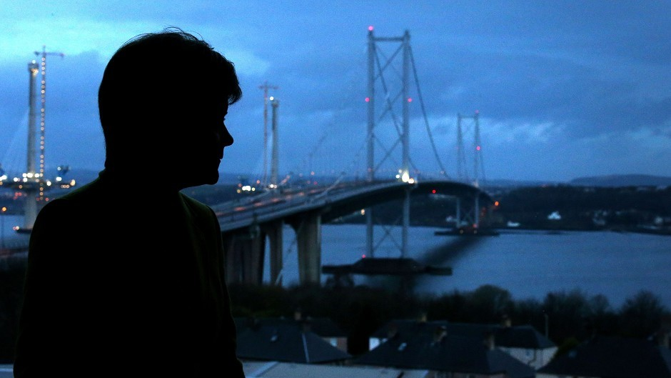 First Minister Nicola Sturgeon looks out over the closed Forth Road Bridge
