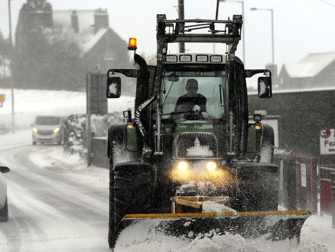 A snow plough clears the road