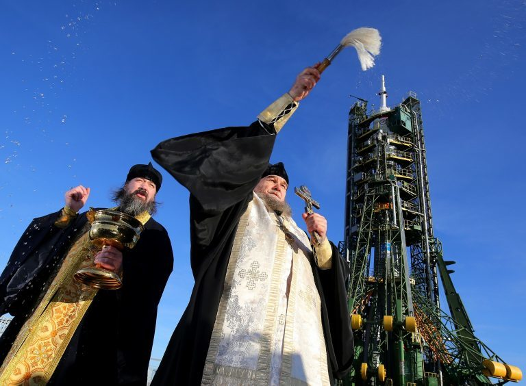 A Russian Orthodox priest blesses the media and well-wishers after a service at the Baikonur Cosmodrome in Kazakhstan to bless the Soyuz FG rocket which will carry British astronaut Tim Peake to the International Space Station tomorrow.